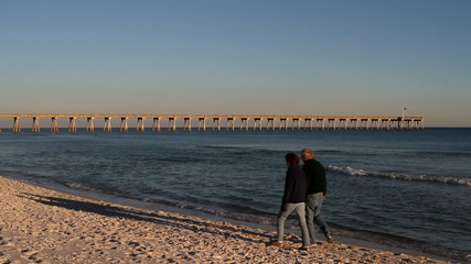 Retirees Walk Down Beach