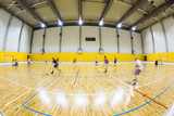 interior of a modern multifunctional gymnasium with young people poster