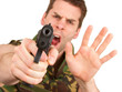 Soldier in camouflage vest is holding a gun