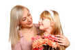 Mother and daughter with flowers looking at each other isolated