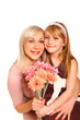 Hugging mother and daughter with flowers isolated on white