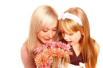 Mother and daughter sniffing flowers isolated on white backgroun