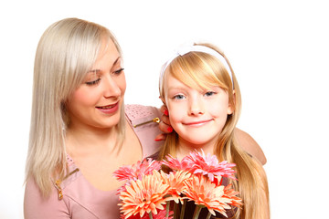 Smiling mother and daughter with flowers isolated on white backg