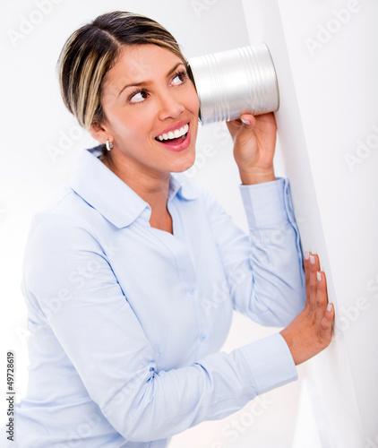 Businesswoman listening to secrets