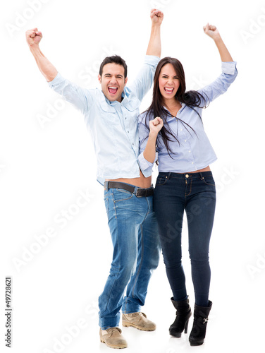 Happy couple with arms up