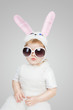 Boy wearing a bunny rabbit costume and sunglasses