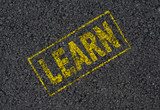 Learn word stamped on asphalt background