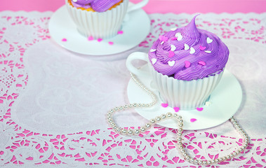cake in a teacup with pearls