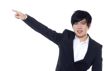 Portrait of young business man in suit pointing