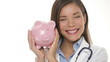 Medical doctor holding piggy bank money concept