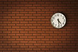 clock on brick wall
