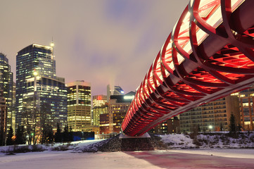Calgary skyline and peace bridge at night.