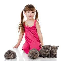 Happy girl and British kittens. isolated on white