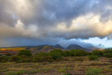 Sun breaks through dramatic storm clouds and shines on West Maui