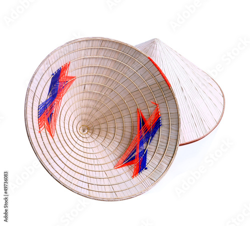 Asian conical hat with pink tie, isolated on white.