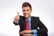 business man at desk showing thumbs up
