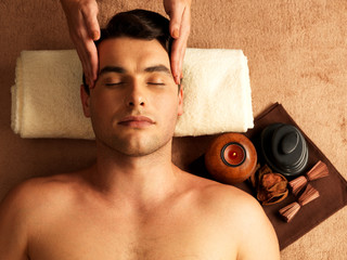 Man having head massage in the spa salon