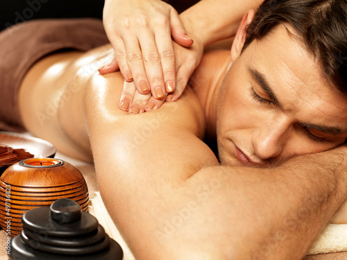 canvas print picture Man having massage in the spa salon