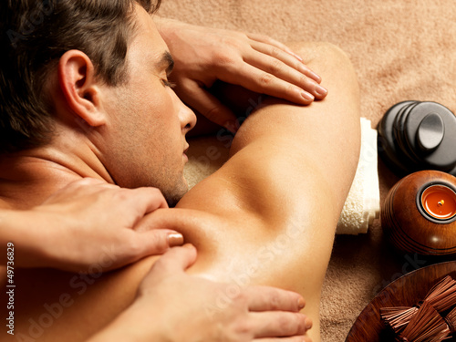 Leinwandbild Motiv Man having massage in the spa salon