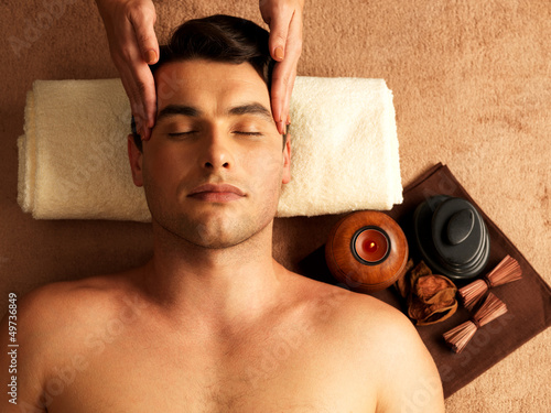 Man having head massage in the spa salon