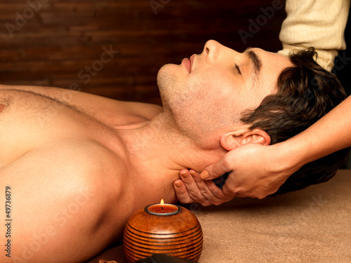 Man having neck massage in the spa salon
