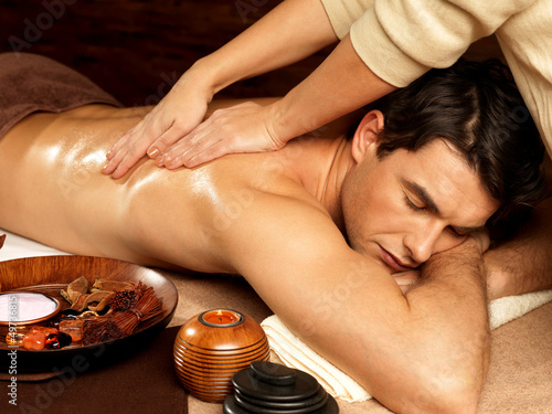Poster, Tablou Man having massage in the spa salon