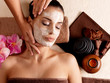 Spa massage for woman with facial mask on face - 49737074
