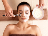 Fototapety Spa therapy for woman receiving facial mask