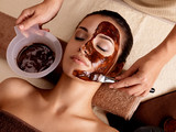 Spa therapy for woman receiving cosmetic mask - 49737085