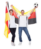 Young couple cheering for Germany
