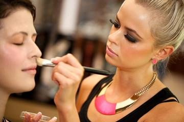 Attractive female make up artist at work.