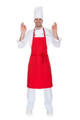 Portrait of cheerful chef in uniform
