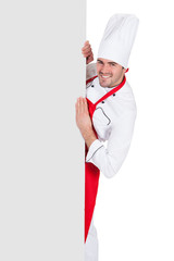 Chef in uniform presenting empty banner