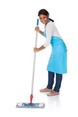 Cheerful Woman Having Fun While Cleaning