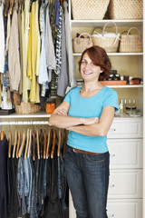 Smiling woman near closet