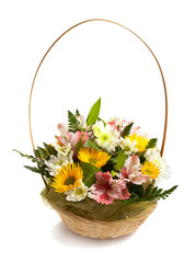 Basket with spring flowers isolated