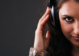 beautiful brunette in headphones