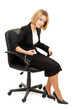 Young beautiful business woman strapped to chair with handcuffs