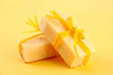 Natural handmade soap, on yellow background