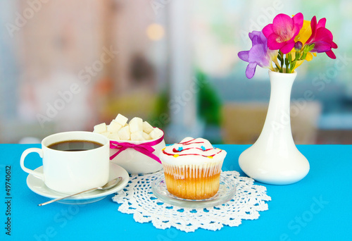 Cupcake on saucer with glass cover, on bright background