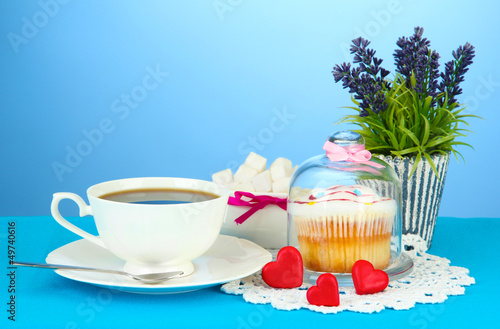 Cupcake on saucer with glass cover, on color background