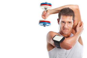 Young man lifting weight and listening to portable music