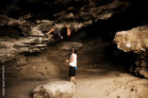Young woman taking climbing lessons