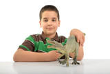 Cute child playing with dino isolated on white background