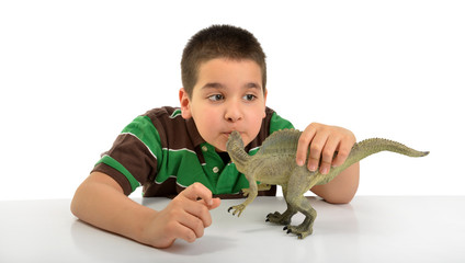 Cute boy kissing spinosaurus