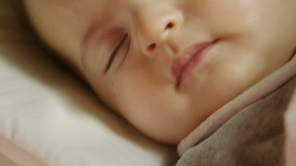 Infant sleep, cute little female child napping in bed at home