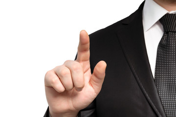Isolated businessman in a suit and points the finger at an objec