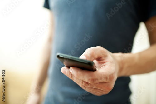 canvas print picture Close up of a man using mobile smart phone