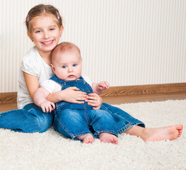 Two sisters sitting on the floor