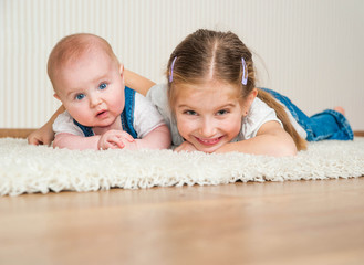 two sisters lying on the floor